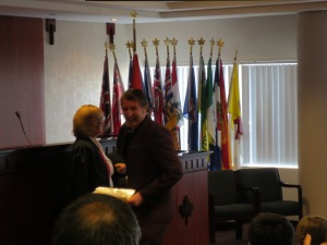 Dan charming the judge at his swearing in ceremony.